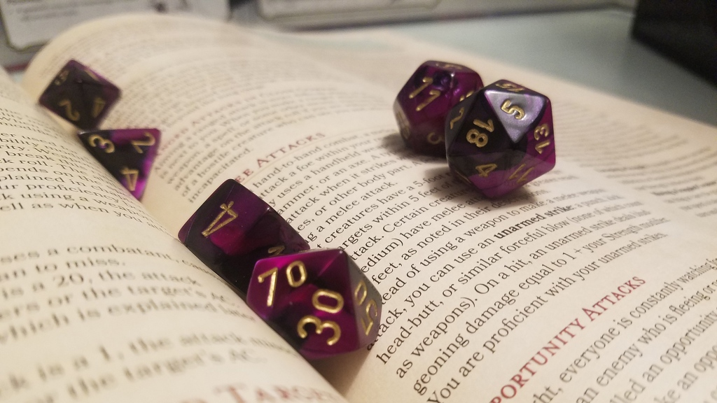 gaming dice on a dungeons and dragons manual